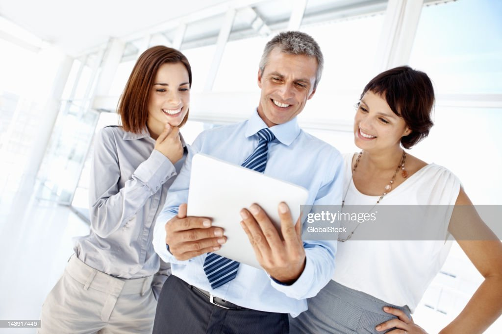 Business man using electronic tablet : Stock Photo