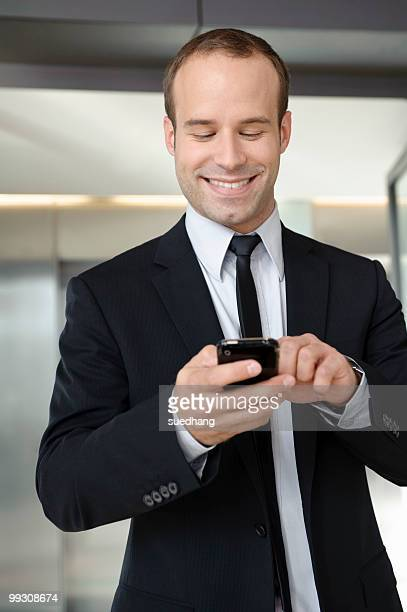Business man using mobile in office