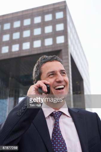 Business man using mobile phone outside : Stock Photo