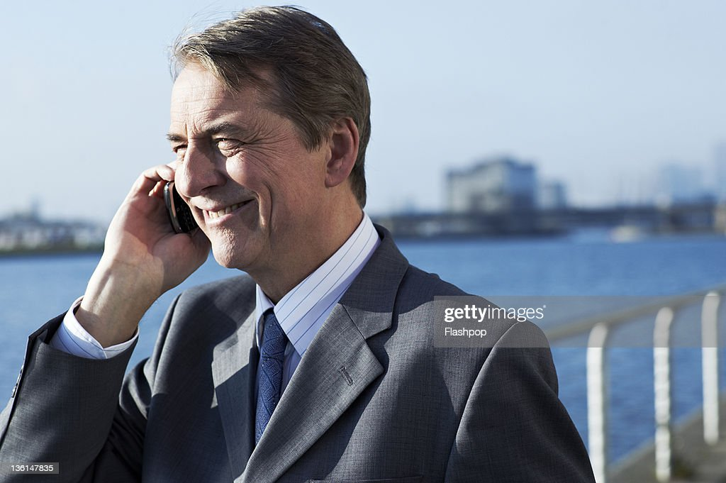Business man using mobile phone : Stock Photo