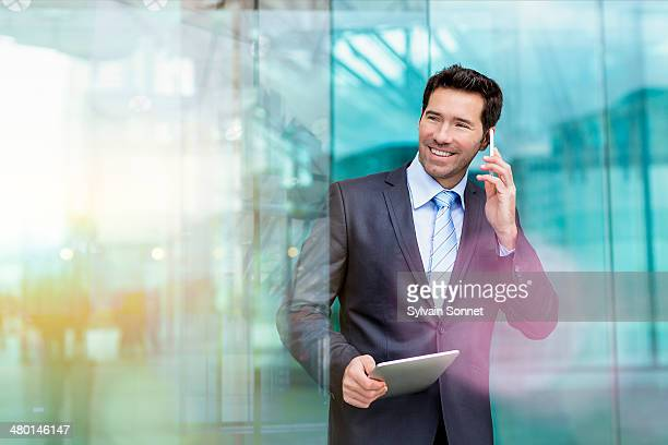 Business man using phone and Digital Tablet