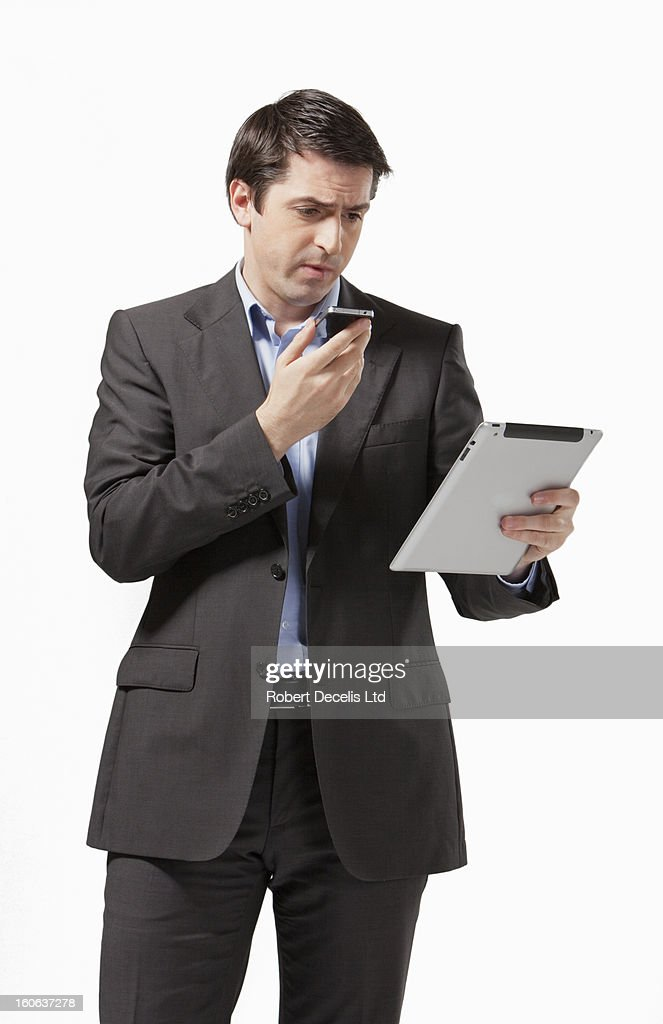 Business man using smart phone and tablet : Stock Photo