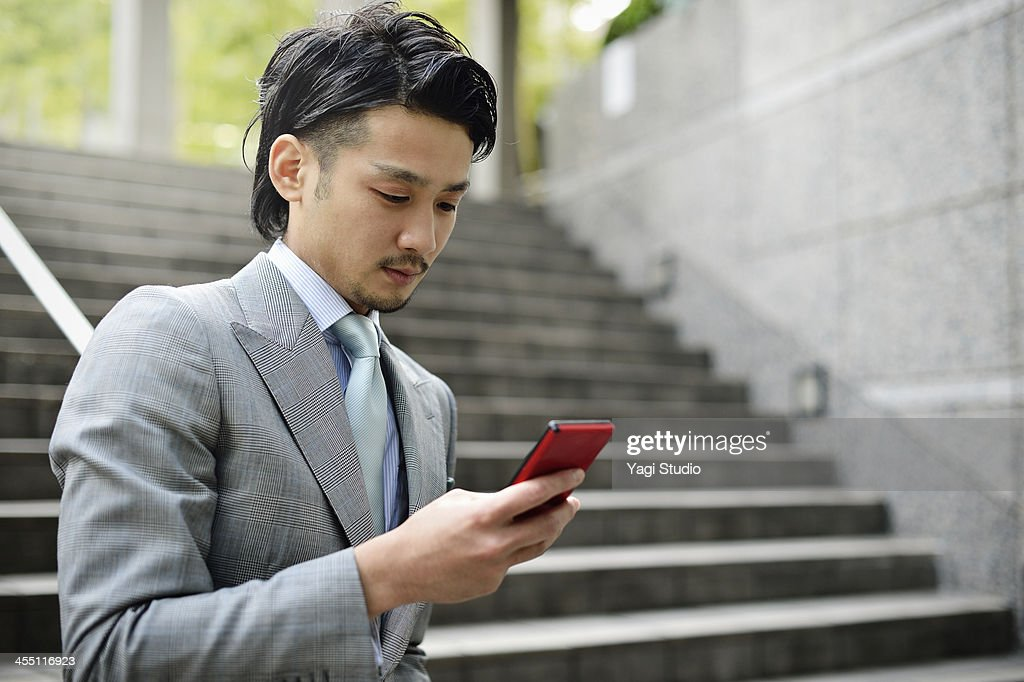 Business man using smartphone in buildings : Stock Photo