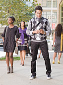 Business man using smartphone on street