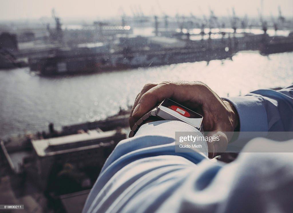 Business man using smartwatch.