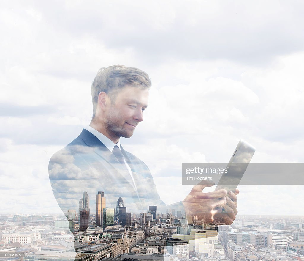 Business man using tablet with London view. : Stock Photo