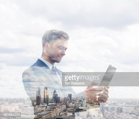 Business man using tablet with London view.