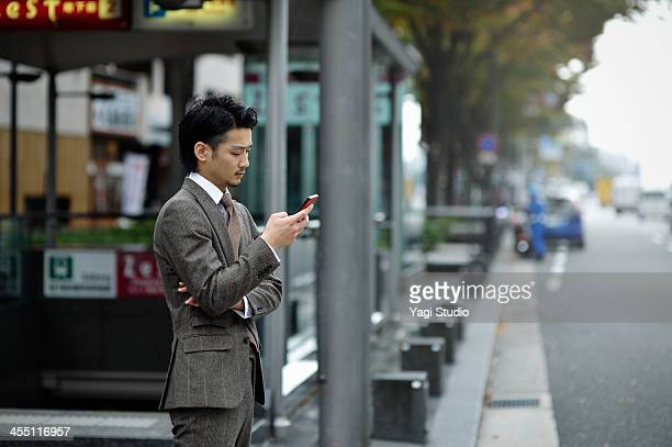 Business man using the smartphone in the city