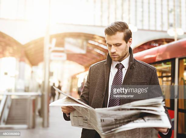 Business man waiting the train on railway station