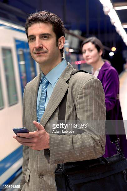 Business man waits for subway