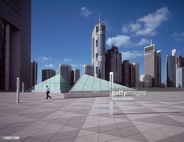 Business man walking in office park in Dubai