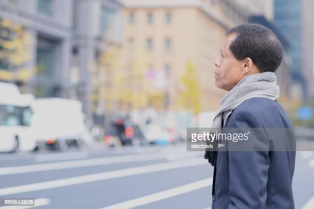 Business man walking outside
