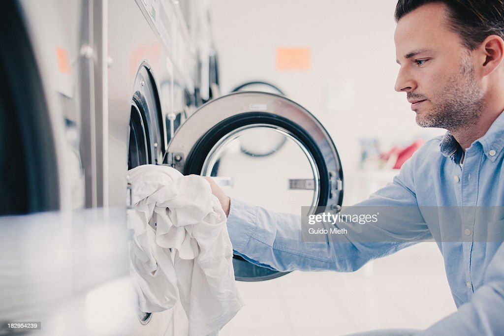 Business man washing clothes