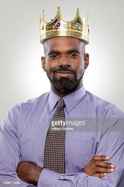 Business man wearing crown