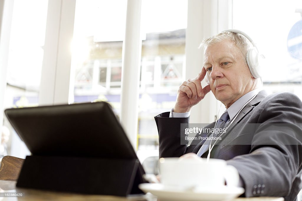 business man wearing headphones using technology : Stock Photo