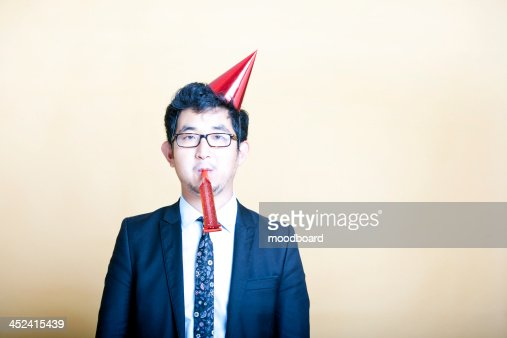 business man wearing party hat : Stock-Foto