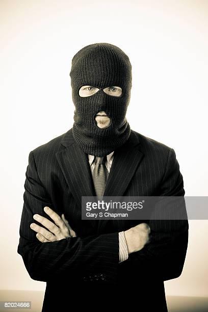 Business man wearing ski mask