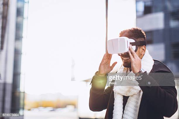 Business man wearing virtual reality headset