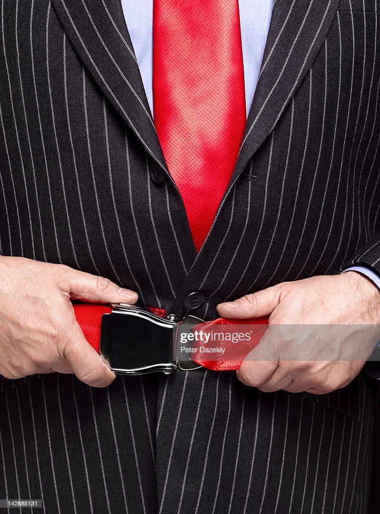 Business man with aeroplane seat belt : Stock Photo