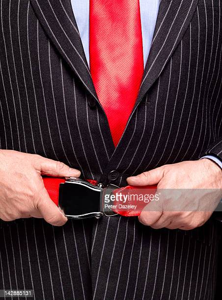 Business man with aeroplane seat belt