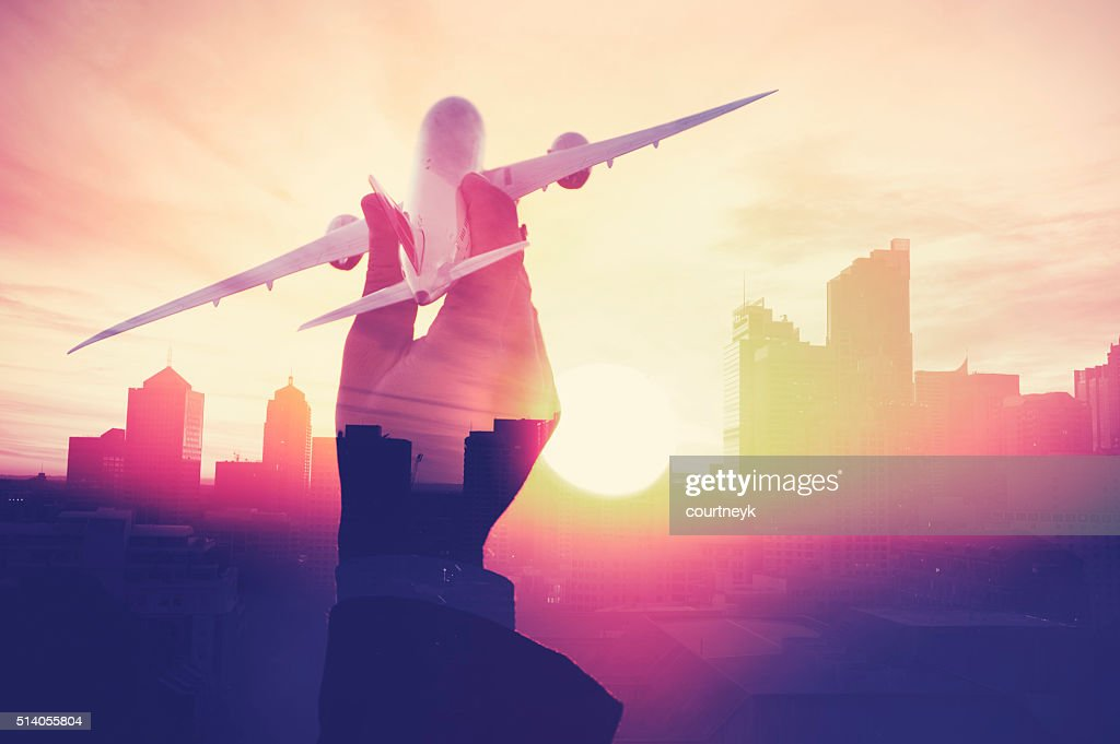 Business man with airplane with cityscape montage. : Stock Photo