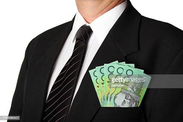 Business Man with Australian Money in his pocket white background