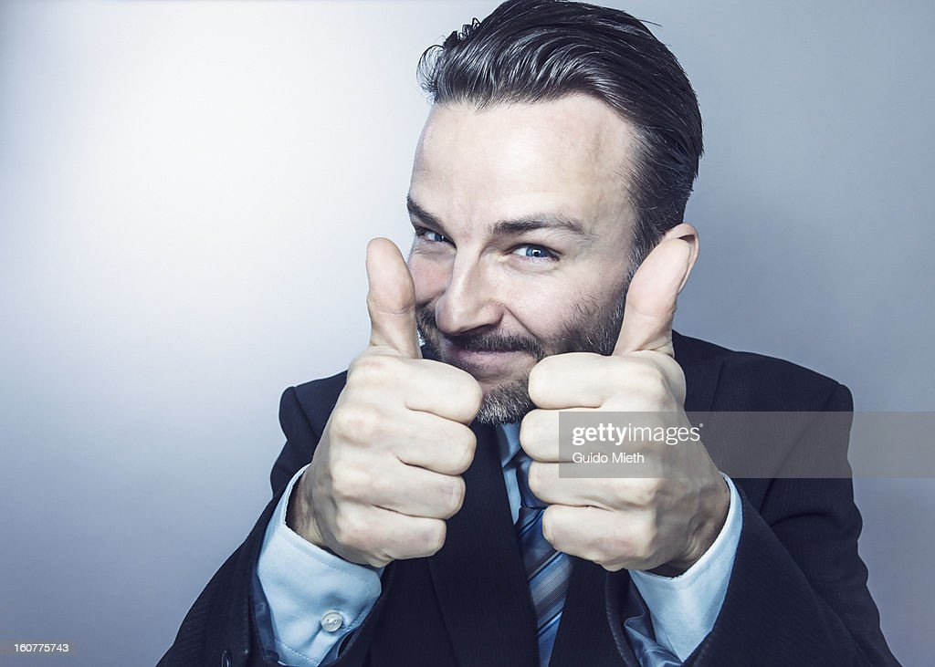 Business man with both thumbs up. : Stock Photo
