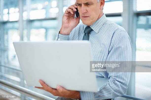 Business man with cell phone and laptop