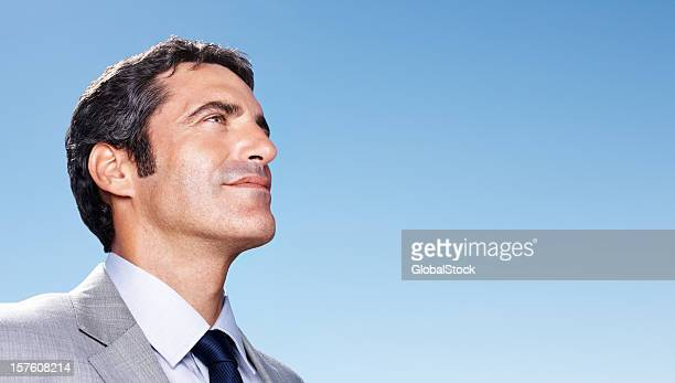 Business man with copy space against blue sky