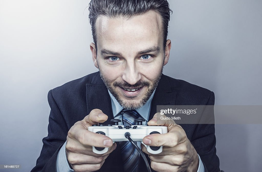 Business man with game controller.
