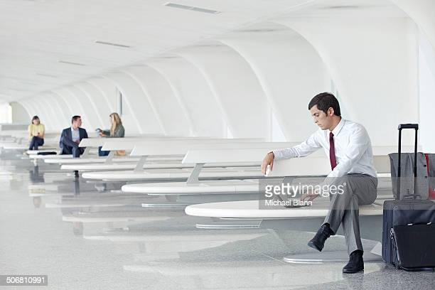 business man with laptop at airport