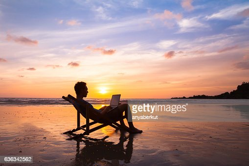 business man with laptop working on the beach : Stock Photo