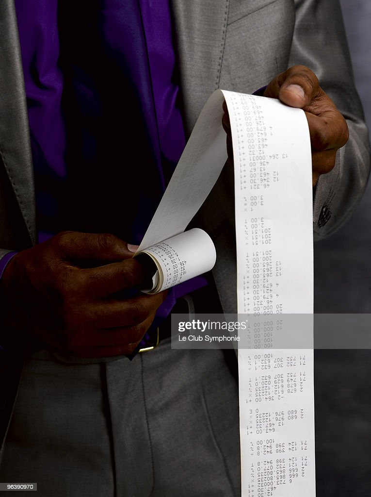 Business man with long paper receipt : Stock Photo