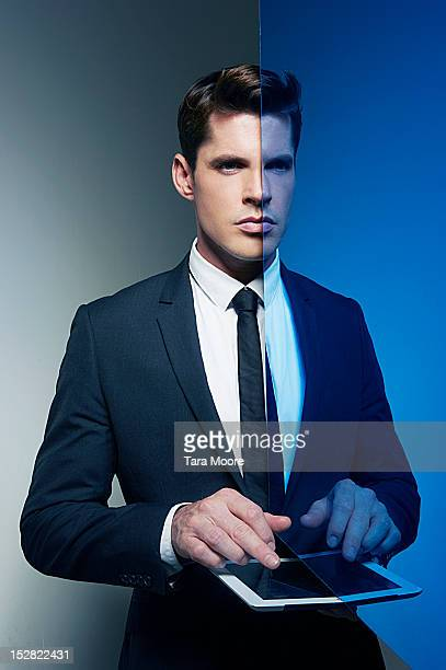 business man with mirror image with digital tablet