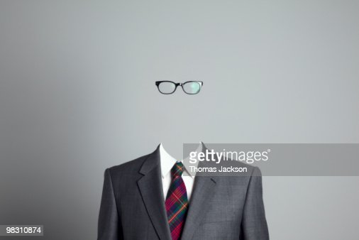 Business man with no face, looking at camera