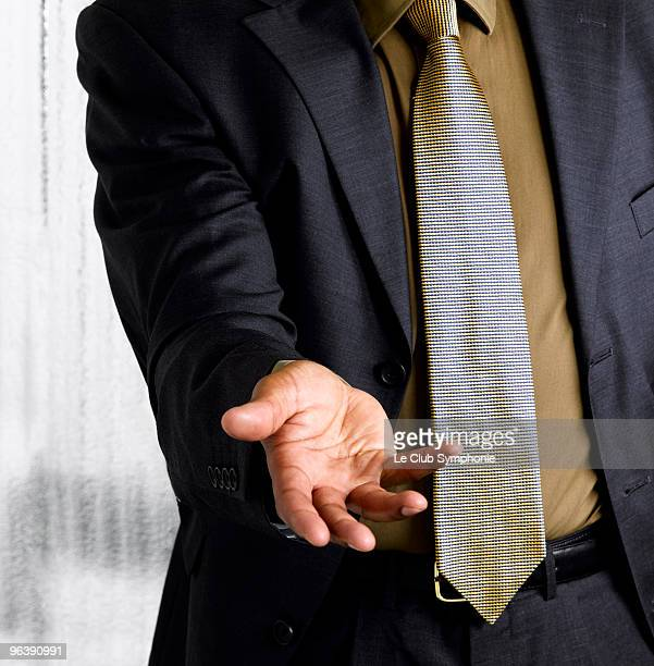 Business man with open hand out