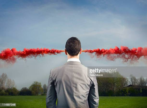 business man with red smoke coming from ears