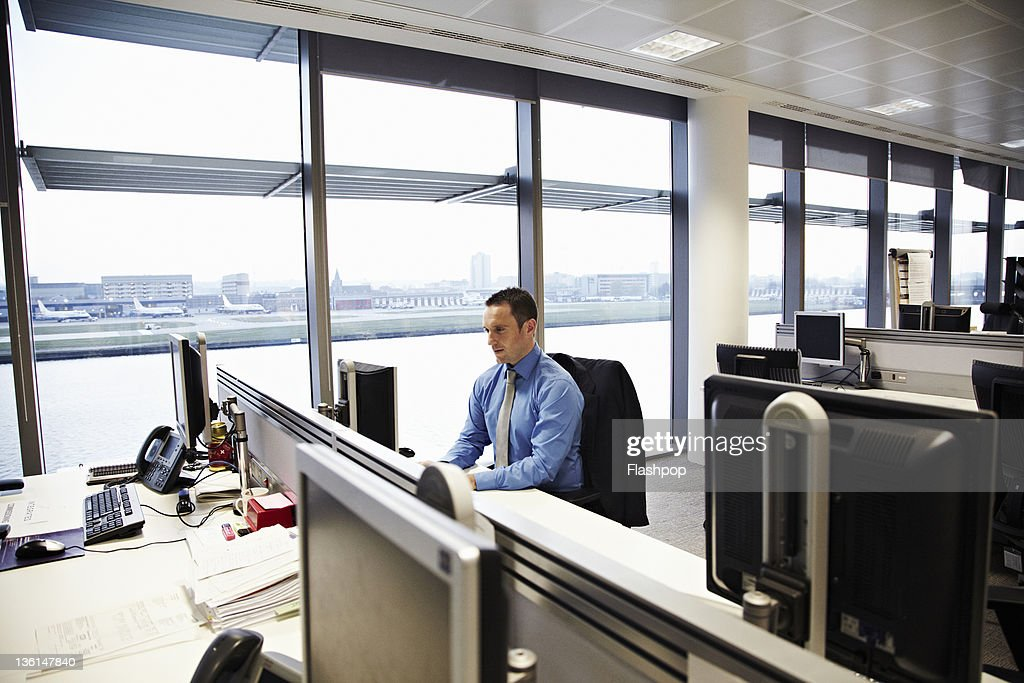 Business man working at desk : Stock Photo