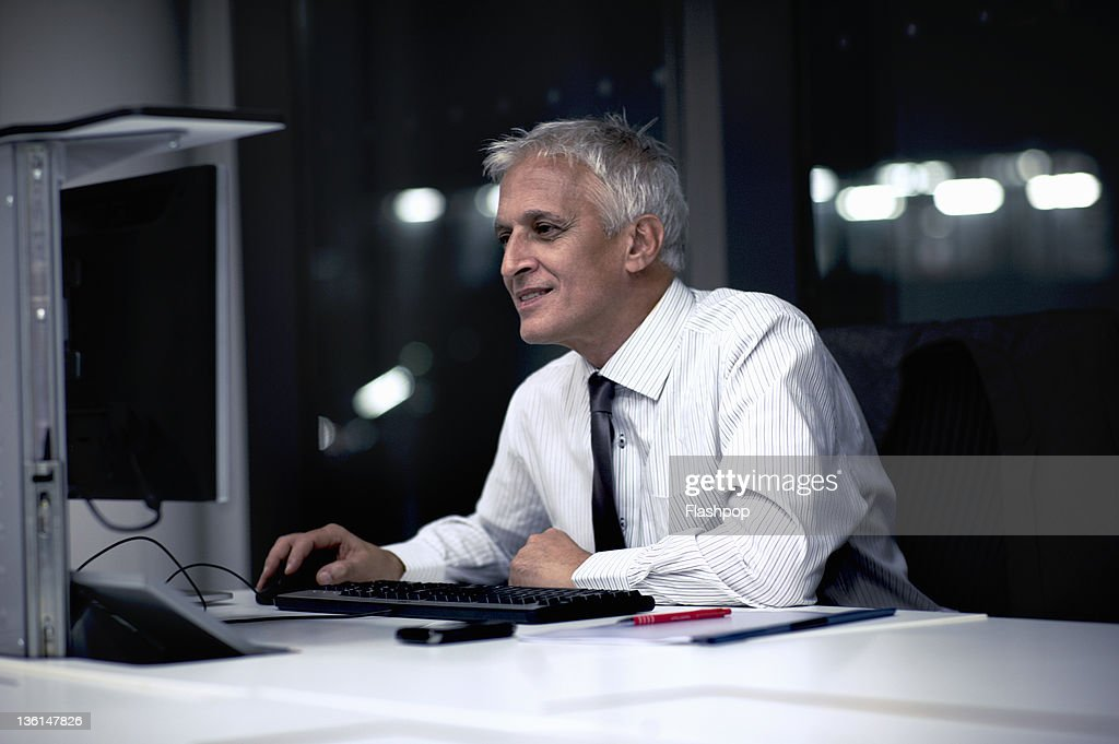 Business man working late working on computer : Stock Photo