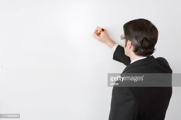 Business Mann Schreiben auf whiteboard