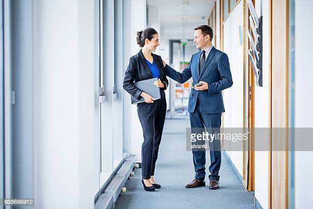 Business manager appreciating female colleague's work