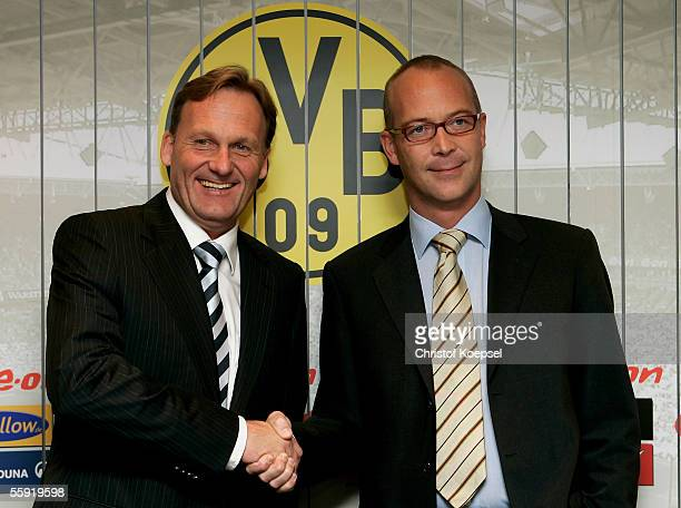 Business manager HansJoachim Watzke of Borussia Dortmund and business manager of the KGaA shake hands to the Thomas Tress who will be the new busines...
