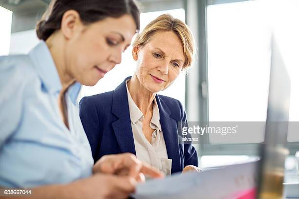 Business manager presenting financial data to her colleague