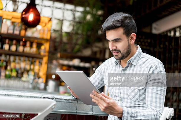 Business manager working online at a restaurant