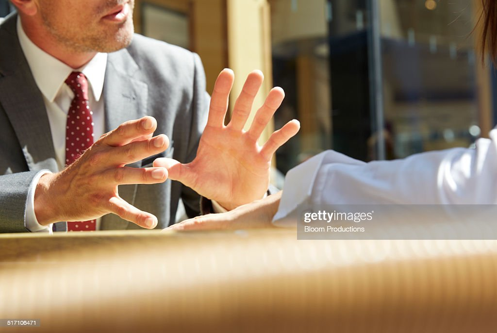 Business mans hands making a gesture : Stock Photo