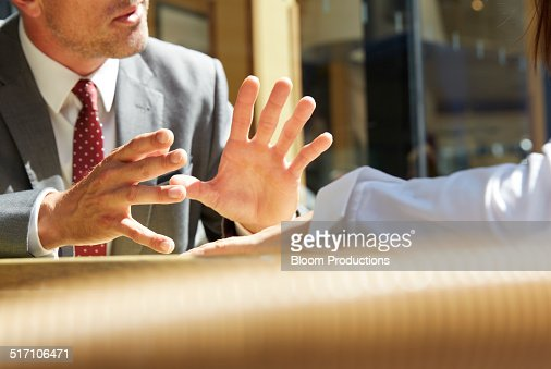 Business mans hands making a gesture