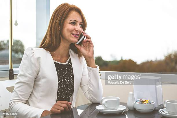 Business Meeting At The Cafè - Woman