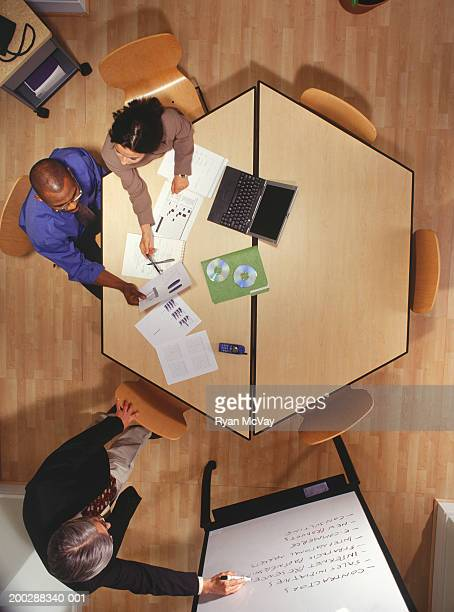 Business meeting in office, overhead view