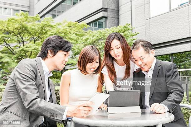 Business meeting in office's garden