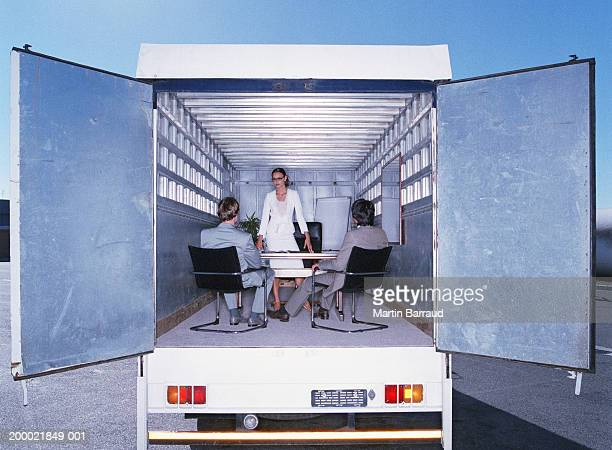 Business meeting inside lorry